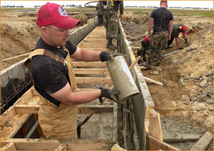 Pouring concrete into the wood forms at the Kunsan air base